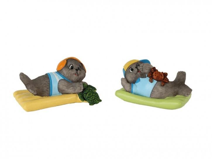 25150 Comic-Seehund auf dem Luftbett